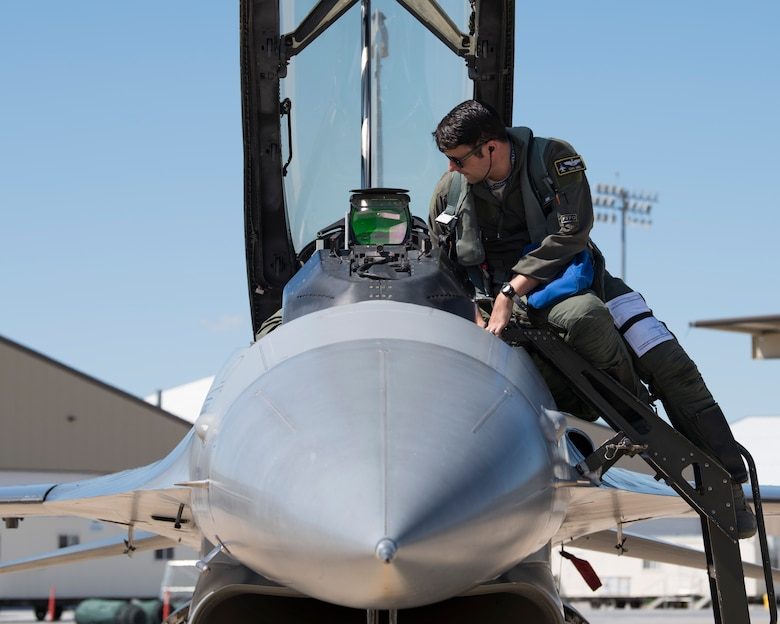 Maj. David Abel, 311th Fighter Squadron instructor pilot, exits his assigned F-16 Viper after a familiarization flight, May 2, 2019, on Hill Air Force Base, Utah. The 311th FS deployed to Hill for exercise Venom 19-01, April 22 - May 3, to perform dissimilar air combat training with the F-35 Lightning II. (U.S. Air Force photo by Staff Sgt. BreeAnn Sachs)