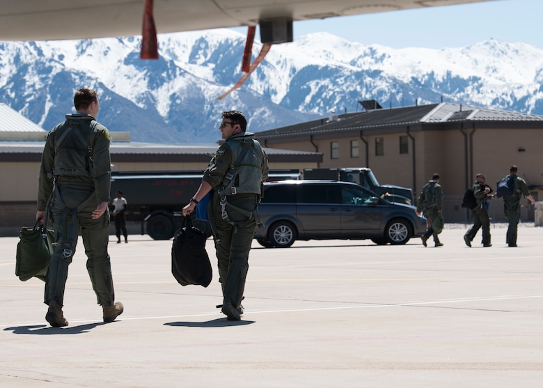 Maj. David Abel, 311th Fighter Squadron instructor pilot, and 2nd Lt. Sean Stegemoller, 54th Operation Support Squadron intelligence officer, walk across the flightline, May 2, 2019, on Hill Air Force Base, Utah. Abel flew the final sortie of his instructor pilot upgrade training, April 23, 2019, during the first day of exercise Venom 19-01, and flew Stegemoller in his first familiarization flight the last day of the exercise. (U.S. Air Force photo by Staff Sgt. BreeAnn Sachs)