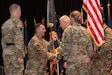 Incoming 83rd U.S. Army Reserve Readiness Training Center commander Col. Steven Egan passes the unit's colors to Command Sgt. Maj. Edward Roderiques, signifying the transfer of command from former commander Col. Kathleen Porter, during a ceremony at Waybur Theater May 3. (Photo Credit: Renee Rhodes, Fort Knox Visual Information )