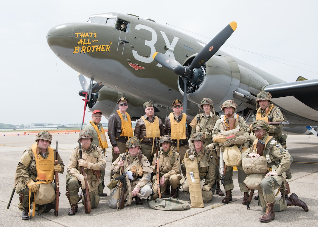 World War II reenactors pose in front of a Douglas C-47 Skytrain at the D-Day 75th Anniversary Commemoration May 4, 2019, at the Air Mobility Command Museum on Dover Air Force Base, Del. The plane was open for cabin and cockpit tours throughout the day.  (U.S. Air Force Photo by Mauricio Campino)