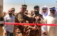 U.S. Army Col. Guy Reedy, 1st Theater Sustainment Command's Operational Command Post chief of staff,  Kuwait Col. Abdullah Hamed Al-Masamah,  Khabari Crossing operations manager, and Jamal Al-Julawi, director general of customs administration cut the ribbon on a newly rennovated facility at Khabari Crossing, Kuwait, April 30, 2019.