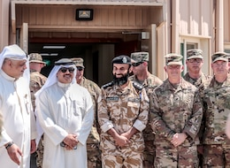 U.S. Army and Kuwait partners gather for a photo during the Khabari Crossing ribbon cutting ceremony April 30, 2019.