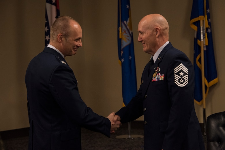 188th Wing Commander, Col. Robert I. Kinney, shakes hands with Chief Master Sgt. Stephen R. Bradley, 188th Wing command chief master sergeant, during a retirement ceremony held May 4, 2019, at Ebbing Air National Guard Base, Arkansas. Bradley served 37 years as a dental technician, first sergeant, and eventually 188th Wing command chief. (U.S. Air National Guard photo by Tech. Sgt. John E. Hillier)