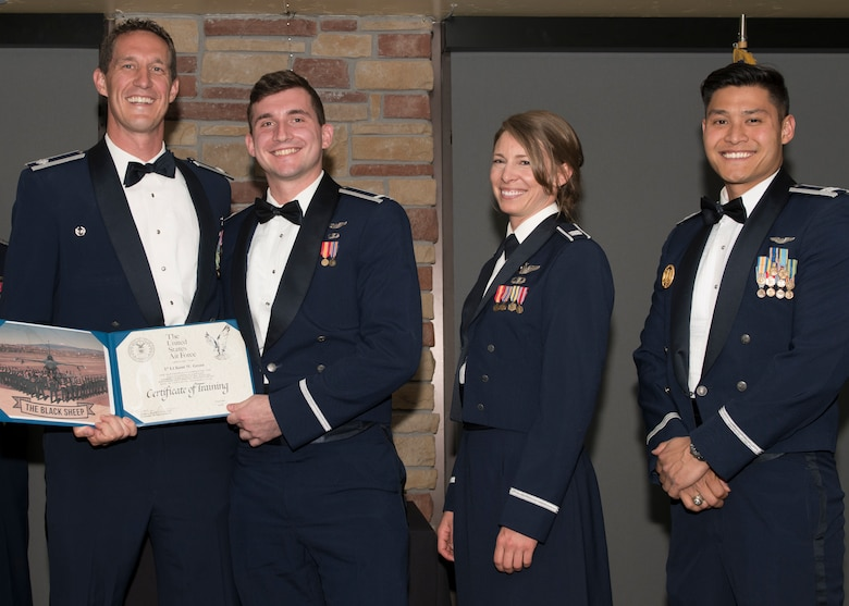 Lt. Col. Mark Sletten, 8th Fighter Squadron commander, presents 1st Lt. Kent Greer, 8th FS F-16 Basic Course graduate, with a certificate of training, May 4, 2019, at Club Holloman on Holloman Air Force Base, N.M. Eight Viper pilot students graduated from the 8th FS first F-16 B-Course, nearly eighty years since the squadron's induction on Nov. 20, 1940. (U.S. Air Force photo by Airman 1st Class Kindra Stewart)