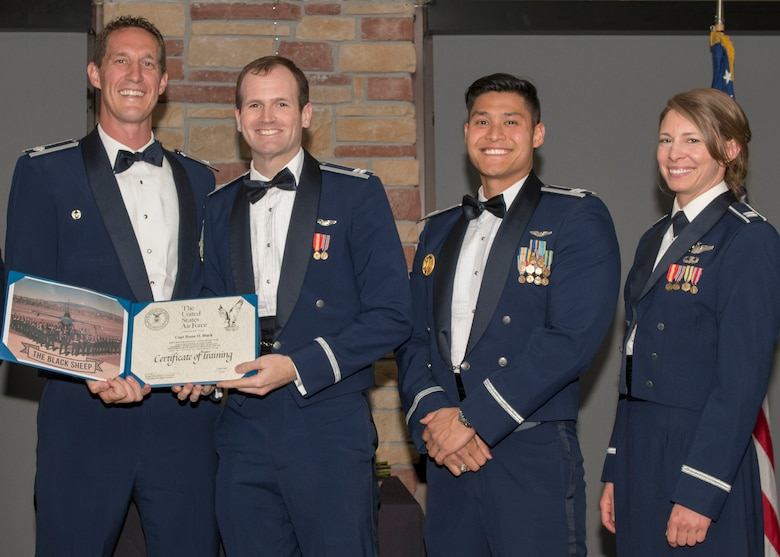 Lt. Col. Mark Sletten, 8th Fighter Squadron commander, presents Capt. Reese Black, 8th FS F-16 Basic Course graduate, with a certificate of training, May 4, 2019, at Club Holloman on Holloman Air Force Base, N.M. Eight Viper pilot students graduated from the 8th FS first F-16 B-Course, nearly eighty years since the squadron's induction on Nov. 20, 1940. (U.S. Air Force photo by Airman 1st Class Kindra Stewart)