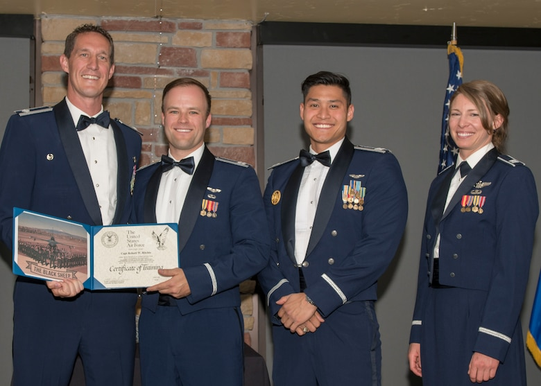 Lt. Col. Mark Sletten, 8th Fighter Squadron commander, presents Capt. Robert Ritchie, 8th FS F-16 Basic Course graduate, with a certificate of training, May 4, 2019, at Club Holloman on Holloman Air Force Base, N.M. Eight Viper pilot students graduated from the 8th FS first F-16 B-Course, nearly eighty years since the squadron's induction on Nov. 20, 1940. (U.S. Air Force photo by Airman 1st Class Kindra Stewart)