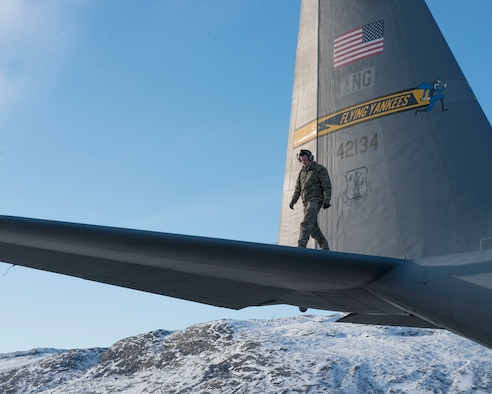 Tech. Sgt. Trenton Zanow, 118th Airlift Squadron flight engineer, inspects the wing of a C-130H aircraft, April 2, 2019, in Kangerlussuaq, Greenland. The 118th flew to Greenland in support of the National Science Foundation climate research mission.