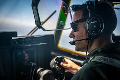 5/11 and VMGR-352 Marines load HIMARS onto KC-130J
