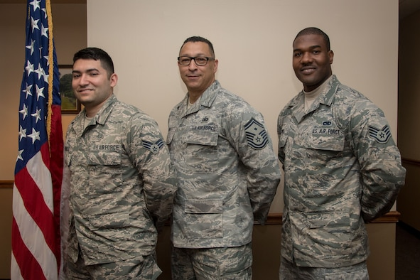Senior Airman Saul Gonzalez, 514th Aeromedical Staging Squadron medic, Senior Master Sgt. David Gold, 88th Aerial Port Squadron first sergeant, and Staff Sgt. Ainsley J. Atwell, 714th Aircraft Maintenance Squadron aerospace propulsion and jet mechanic, all with the 514th Air Mobility Wing, Joint Base McGuire-Dix-Lakehurst, N.J., pose for a photo May 5, 2019, here. The three Reserve Citizen Airmen split their time between working as Airmen in three different squadrons at the Freedom Wing and firefighters at Engine Company 238 of the New York City Fire Department. Gold, a lieutenant in the FDNY, supervises Atwell and Gonzalez while at work in the firehouse.