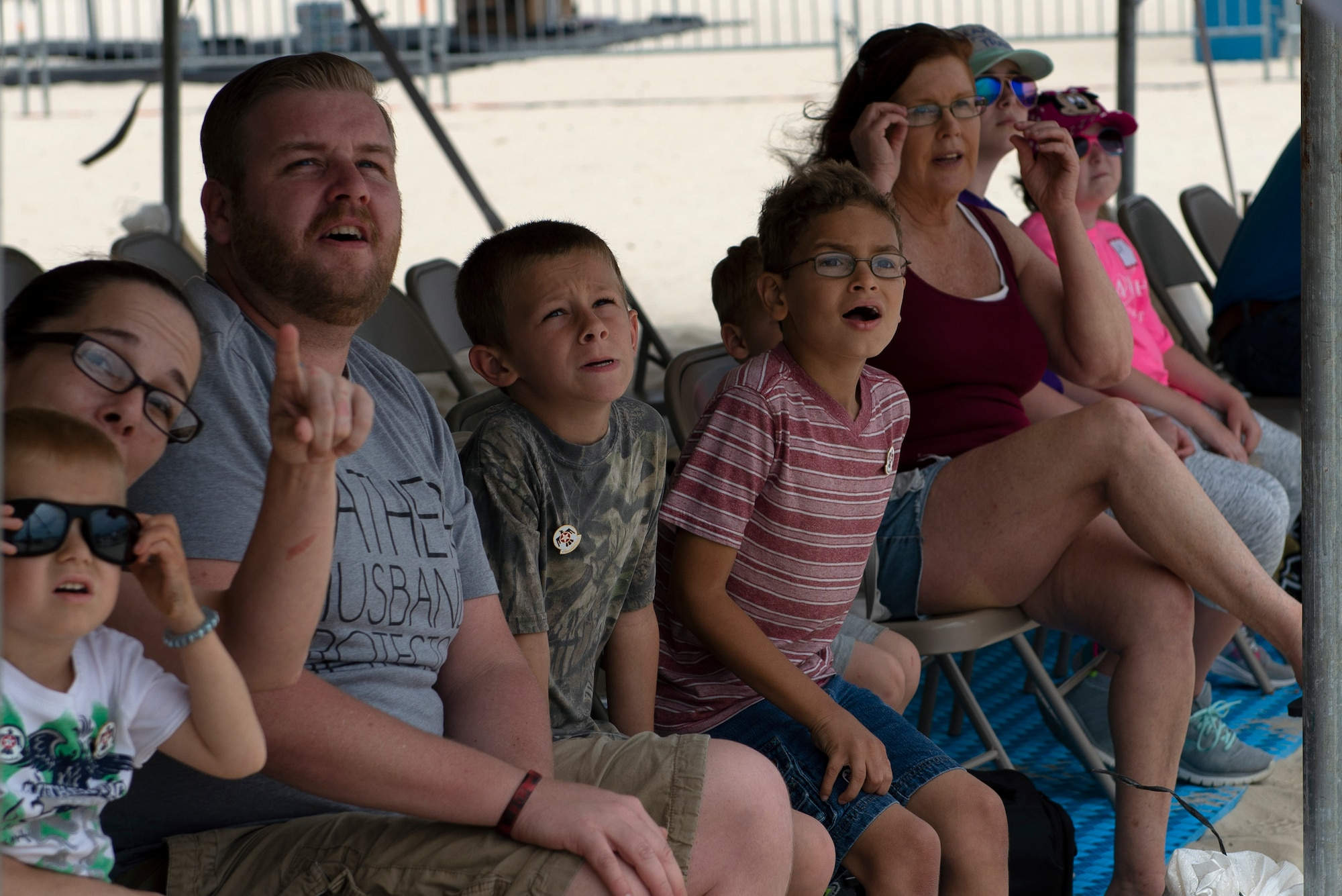 Make-A-Wish families watch the Thunderbirds fly in a practice session for the Keesler and Biloxi Air Show in Biloxi, Mississippi, May 3, 2019. After the practice session, the families were able to meet and get photos with the Thunderbird team. (U.S. Air Force photo by Airman 1st Class Kimberly L. Mueller)