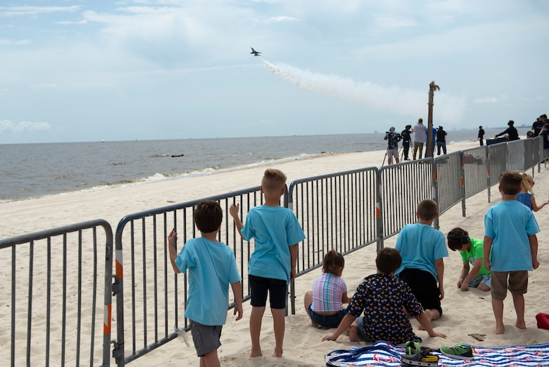 Children in the Make-A-Wish program and their families line up to watch the Thunderbirds fly during a practice session for the Keesler and Biloxi Air Show in Biloxi, Mississippi, May 3, 2019. After the practice session, the families were able to meet and get photos with the Thunderbird team. (U.S. Air Force photo by Airman 1st Class Kimberly L. Mueller)