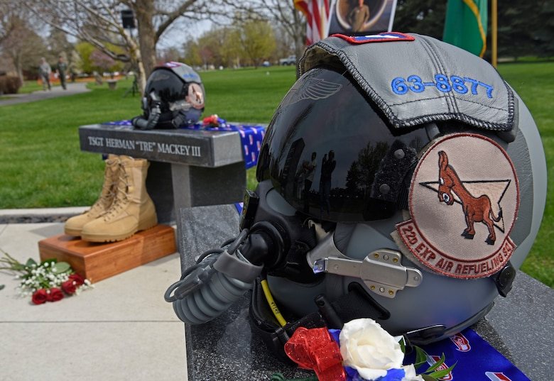 """An aircrew helmet rests on top of U.S. Air Force Capt. Mark """"Tyler"""" Voss memorial site during a Shell 77 memorial ceremony at Fairchild Air Force Base, Washington, May 3, 2019. Voss and two other Fairchild Airmen, Capt. Victoria """"Tory"""" Pickney and Tech. Sgt. Herman """"Tre"""" Mackey III took their last flight on May 3, 2019, when their KC-135 Stratotanker, tail number 63-8877, crashed over Kyrgyzstan in support of Operation Enduring Freedom. (U.S. Air Force photo by Senior Airman Jesenia Landaverde)"""