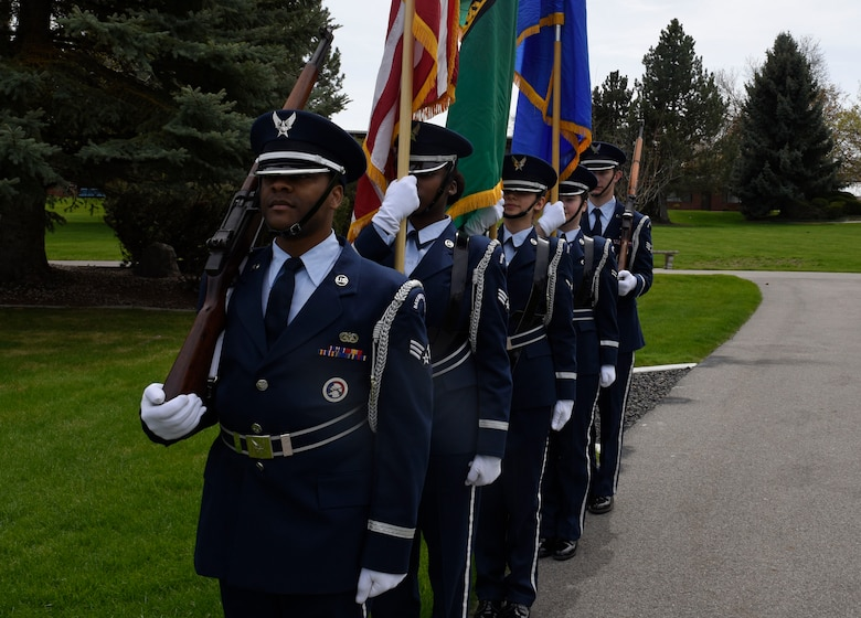 """Fairchild Honor Guard Airmen prepare to present the colors during a Shell 77 memorial ceremony at Fairchild Air Force Base, Washington, May 3, 2019. Fairchild paid tribute to the Shell 77 aircrew, Capt. Mark """"Tyler"""" Voss, Capt. Victoria """"Tory"""" Pickney and Tech. Sgt. Herman """"Tre"""" Mackey III. These Fairchild Airmen sacrificed their lives in support of Operation Enduring Freedom in May 3, 2013. (U.S. Air Force photo by Senior Airman Jesenia Landaverde)"""