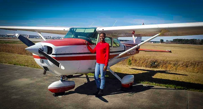 Staff Sgt. Shakeyna Smith, aviation resource management technician with the 701st Airlift Squadron at Joint Base Charleston, stands next to a Cessna 172 before taking flight, Jan. 25, 2019, in North Charleston, South Carolina. Smith completed 72 hours of flight time through Charleston Regional Accelerated Flight Training and IFR6 of N. Charleston, S.C., before persuing a commision in the U.S. Air Force to pilot C-17 Globemaster III's while being a single parent of two, a full-time college student and an Air Force Reservist. (Courtesy photo/Staff Sgt. Shakeyna Smith)