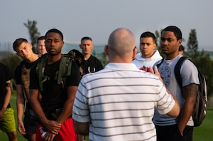 William McEvoy, Chief Historian assigned to the 18th Wing, center, speaks to service members and veterans during the Holocaust Remembrance Week Ruck March at Kadena Air Base, Japan, May 2, 2019.