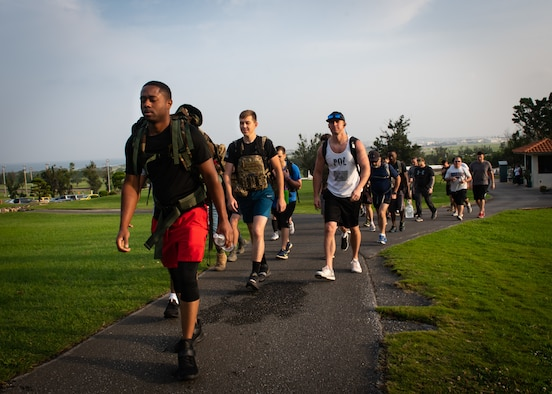 Participants hike around the Banyan Tree Golf Course during the Holocaust Remembrance Week Ruck March at Kadena Air Base, Japan, May 2, 2019.