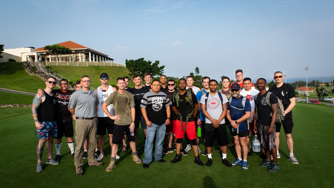 Service members and veterans pose for a photo after the Holocaust Remembrance Week ruck march at Kadena Air Base, Japan, May 2, 2019.