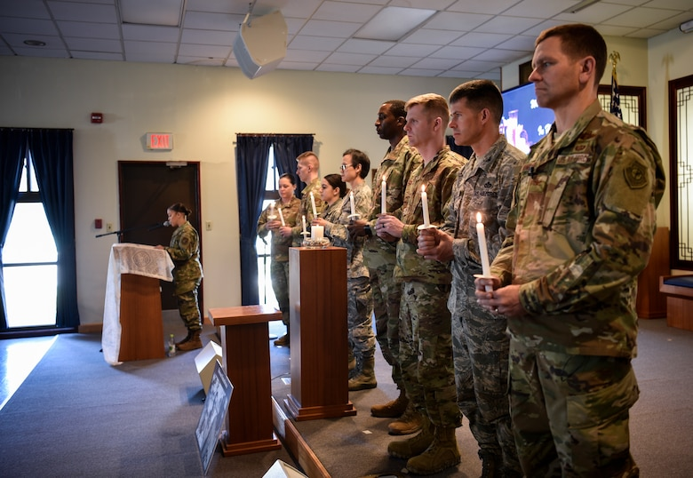 "Airmen hold candles to commemorate Holocaust victims and survivors during a remembrance ceremony on Kunsan Air Base, Republic of Korea, May 2, 2019. The theme of this year's remembrance is ""Learning from the Holocaust: Beyond Religious Boundaries,"" and while many Holocaust victims were in fact Jewish, other innocent targets included Polish, Africans, Muslims, and people with disabilities. (U.S. Air Force photo by Capt. Remoshay Nelson)"
