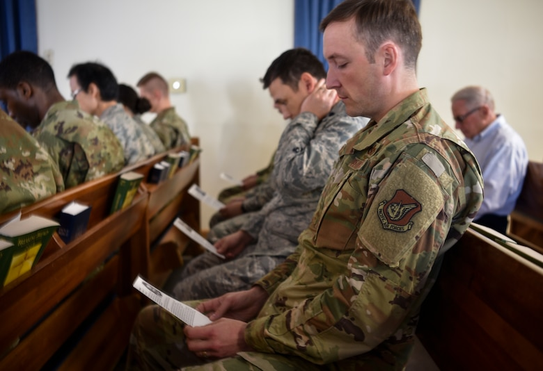 "Airmen read stories of different Holocaust victims and survivors during a remembrance ceremony on Kunsan Air Base, Republic of Korea, May 2, 2019. The theme of this year's remembrance is ""Learning from the Holocaust: Beyond Religious Boundaries,"" and while many Holocaust victims were in fact Jewish, other innocent targets included Polish, Africans, Muslims, and people with disabilities. (U.S. Air Force photo by Capt. Remoshay Nelson)"