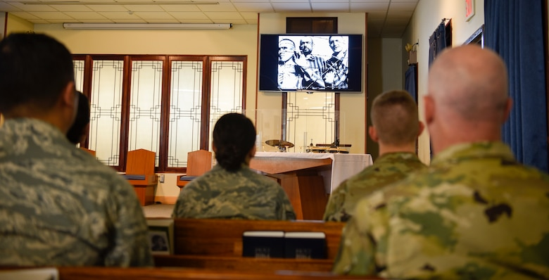 Airmen watch a short film about the Holocaust during a remembrance ceremony on Kunsan Air Base, Republic of Korea on May 2, 2019. The film detailed how the National Socialist German Worker's Party, led by Adolf Hitler, systematically exterminated millions of European Jews and other minorities and charged onlookers to never allow it to happen again. (U.S. Air Force photo by Capt. Remoshay Nelson)