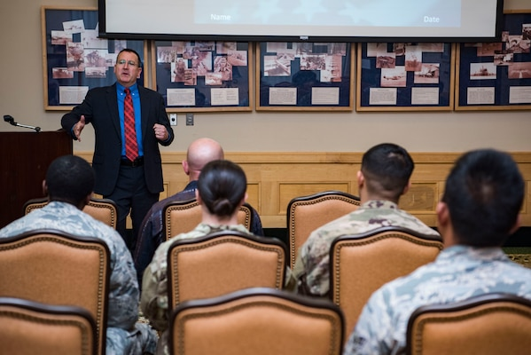 Tom Manganello, Sr., U.S. Securities and Exchange Commission, Office of Education and Advocacy senior counsel, speaks to a group of Airmen April 23, 2019, at Joint Base San Antonio-Lackland, Texas. Personal financial readiness classes at MFRC are offered throughout the year ranging from home buying, savings accounts, building a budget, establishing credit and reducing debt, car buying and managing student loans.