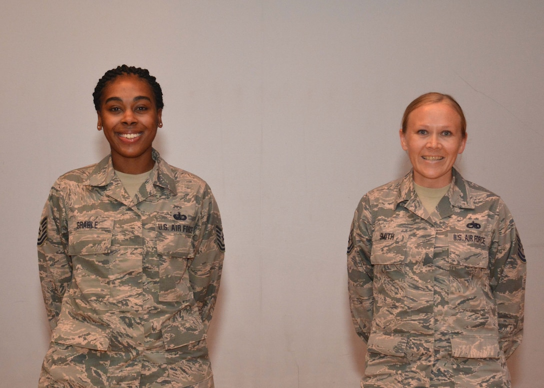 Tech. Sgt. Jocilyn Grable, 507th Air Refueling Wing Development and Training Flight program manager, and Master Sgt. Jessica Smith, 507th Operations Group career assistance advisor, are recognized for recently attaining Community College of the Air Force degrees during the May UTA commander's call at the base theater, May 5, 2019, Tinker Air Force Base, Oklahoma. (U.S. Air Force photo by Senior Airman Mary Begy)
