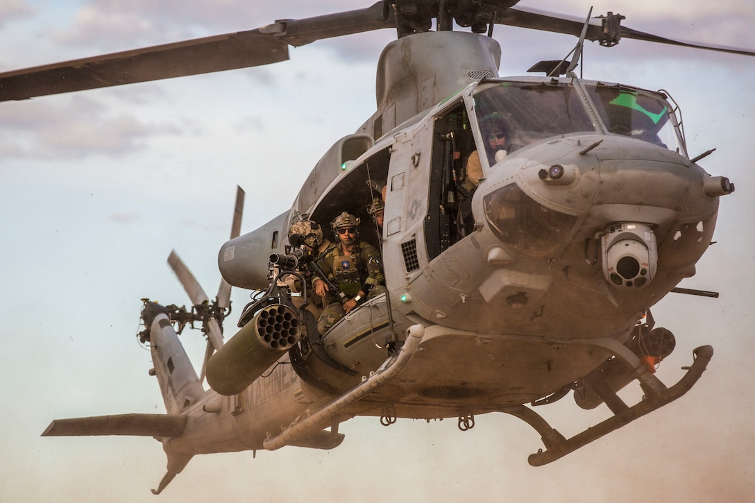 A U.S. Marine Corps UH-1Y Venom aircraft assigned to Marine Aviation Weapons and Tactics Squadron One, MAWTS-1 prepares to land in support of a UH-1 battle drill during Weapons and Tactics Instructor, WTI course 2-19 at Yuma Proving Ground, Arizona, April 5, 2019. WTI is a seven-week training event hosted by MAWTS-1, which emphasizes operational integration of the six functions of Marine Corps aviation in support of a Marine Air Ground Task Force. WTI provides standardized advanced tactical training and certification of unit instructor qualifications to support Marine aviation training and readiness, and assists in developing and employing aviation weapons and tactics.
