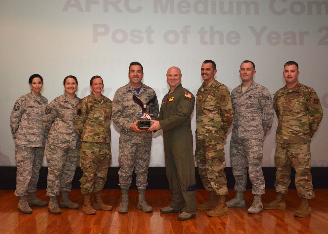 The 507th Air Refueling Wing Commander, Col. Miles Heaslip, stands for a photograph with members of the 507th ARW Command Post for receiving the Medium Command Post of the Year award May 5, 2019, Tinker Air Force Base, Oklahoma. (U.S. Air Force photo by Senior Airman Mary Begy)