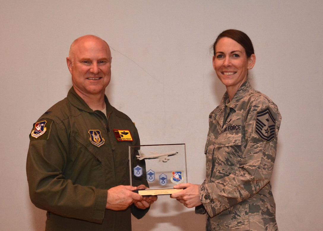 Senior Master Sgt. Natalie Kelly, 507th Force Support Squadron first sergeant, accepts the Senior Noncommissioned Officer of the Quarter award for the first quarter on behalf of Master Sgt. Michelle Bonilla, 507th FSS, during the May UTA commander's call at the base theater, May 5, 2019, Tinker Air Force Base, Oklahoma. (U.S. Air Force photo by Senior Airman Mary Begy)