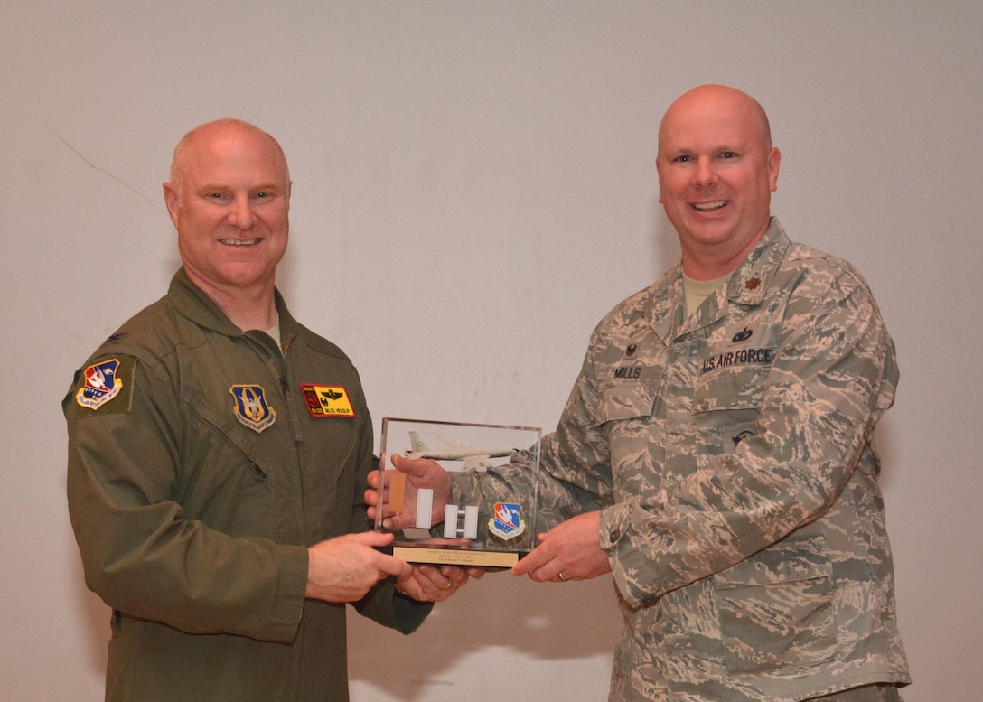 Maj. Jimmie Mills III, 507th Security Forces Squadron commander, accepts the Company Grade Officer of the Quarter award for the first quarter on behalf of 1st Lt. Ryan Cheney, 507th FSS, during the May UTA commander's call at the base theater, May 5, 2019, Tinker Air Force Base, Oklahoma. (U.S. Air Force photo by Senior Airman Mary Begy)