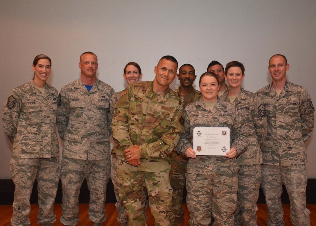 Senior Airman Melisa Rose, 507th Logistics Readiness Squadron, stands with the 507th Air Refueling Wing first sergeants for a photograph after receiving the Diamond Sharp award during commander's call May 5, 2019, Tinker Air Force Base, Oklahoma. (U.S. Air Force photo by Senior Airman Mary Begy)
