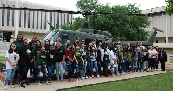 Students in McCollum High School's health science classes visited the U.S. Army Medical Department Center and School, Health Readiness Center of Excellence at Joint Base San Antonio-Fort Sam Houstom May 3 to learn about the many health- and medical-related fields Army Medicine has to offer. Pictured center is McCollum's health science teacher, Karen Rahming, who coordinated the visit.