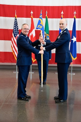 Col. Scott Humphrey presides over the 225th Support Squadron Change of Command where Col. Paige Abbott relinguishes command to Col. Brett Bosselmann at the Pierce County Readiness Center, Camp Murray, Washington, April 10, 2019. (U.S. Air National Guard photo by Capt. Colette Muller)