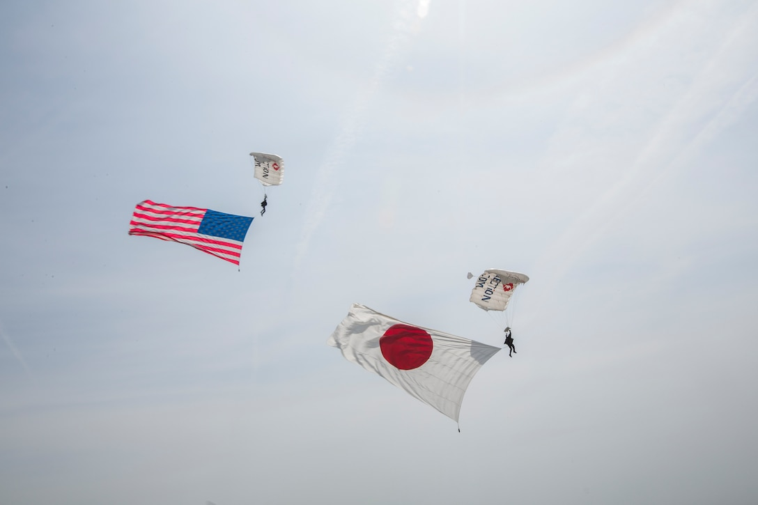 Team Fastrax perform a flag jump during the 43rd Japan Maritime Self-Defense Force – Marine Corps Air Station Iwakuni Friendship Day at MCAS Iwakuni, Japan, May 5, 2019. Since 1973, MCAS Iwakuni has held a single-day air show designed to foster positive relationships and offer an exciting experience that displays the communal support between the U.S. and Japan. The air show encompassed various U.S. and Japanese static display aircraft, aerial performances, food and entertainment.