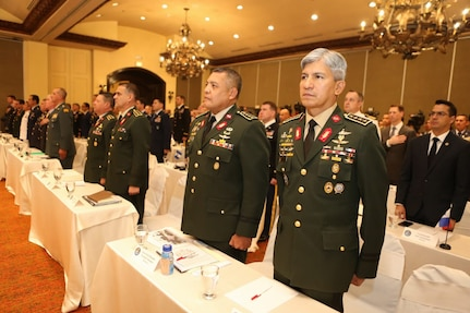Multinational military members stand at attention during the opening of the Central American Security Conference.