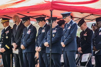 Military leaders and attendees bow their heads during a memorial ceremony May 2, 2019, in Port Wentworth, GA. The event paid homage to the lives of the nine Puerto Rican Air National Guard Airmen who lost their lives when their C-130 Hercules, assigned to the 156th Airlift Wing, crashed May 2, 2018.