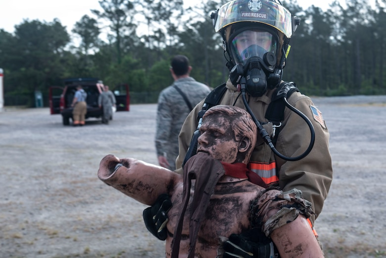 A U.S. Air Force 20th Civil Engineer Squadron firefighter carries a simulated casualty away from a chemical and explosives lab during an exercise at Shaw Air Force Base, S.C., May 2, 2019.