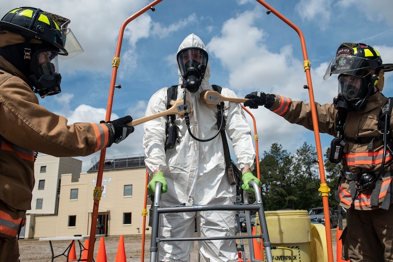 U.S. Air Force firefighters assigned to the 20th Civil Engineer Squadron simulate decontaminating their wingman during an exercise at Shaw Air Force Base, S.C., May 2, 2019.