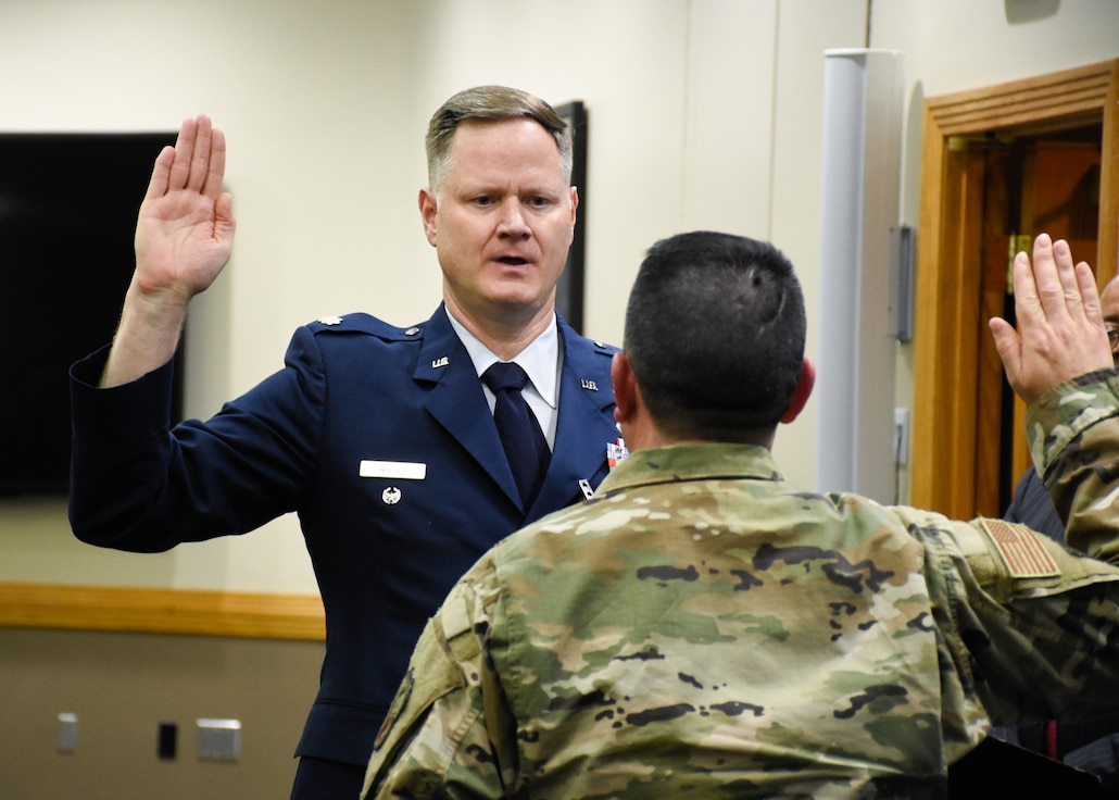 Lt. Col. Joseph B. Walter, the Chief of Public Affairs for the 442d Fighter Wing, administers his last oath of enlistment April 13, 2019, at the consolidated club on Whiteman Air Force Base, Mo. After commissioning in the 442 FW, Walter set a goal to conduct 442 oaths of enlistment before retiring. (U.S. Air Force Photo by Airman 1st Class Alex Chase)