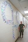 "Sgt. Brittany Callaway stands in front of a Sexual Assault Awareness Month display at Marine Wing Support Detachment 273 aboard Marine Corps Air Station Beaufort, May 1. Callaway had the Marines of the detachment show their support of SAAPM by decorating 998 dog tags to bring awareness to the 998 sexual assaults reported in FY17. ""We talked about how those numbers have gone up, but because Marines are more aware and are more comfortable reporting it because of the education and the climate of their units,"" Callaway said. ""This was also a way to start a sometimes uncomfortable conversation."" Callaway is a sexual assault prevention and response advocate with MWSD-273."