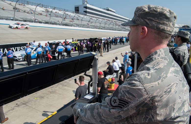 Staff Sgt. Matthew Tatum, 436th Airlift Wing religious affairs Airman, watches the Monster Energy NASCAR Cup Series qualifying race May 3, 2019, at Dover International Speedway, Dover, Del. Tatum,a huge fan of NASCAR, was selected to be one of the approximately 35  honorary pit crew members from Dover Air Force Base. The weekend marked Dover International Speedway's 50th season and the Monster Mile's 100th Monster Energy NASCAR Cup Series race. (U.S. Air Force photo by Senior Airman Christopher Quail)