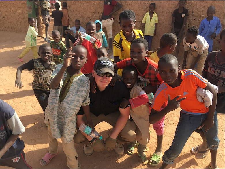 Capt. Ian McNeil, 718th Intelligence Squadron assistant director of operations, was deployed to the African continent where he engaged in a variety of missions, including working to improve the lives of the local population. He helped to build additional classrooms for an overpopulated school and coordinated with the 718th IS to conduct a supplies drive to support the school. (Courtesy photo)
