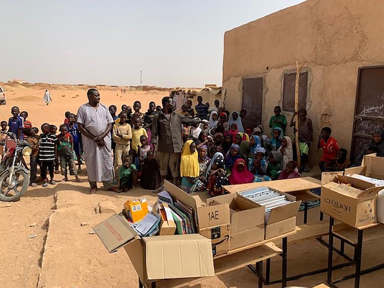 Capt. Ian McNeil, 718th Intelligence Squadron assistant director of operations, was deployed to the African continent where he engaged in a variety of missions, including working to improve the lives of the local population. He helped to build additional classrooms for an overpopulated school and coordinated with the 718th IS to conduct a supplies drive to support the school.
