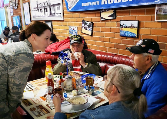 Lt. Col. Neva VanDerSchaegen, 412th Medical Support Squadron commander to talks Art Ray, a World War II Veteran during a Coffee4Vets event in Lancaster, Calif., May 7. Coffee4Vets meets every Tuesday at Crazy Otto's Diner in Lancaster. The group allows currently-serving Airmen to engage with local Veterans and bridges different generations of servicemembers. (U.S. Air Force photo by Danny Bazzell)