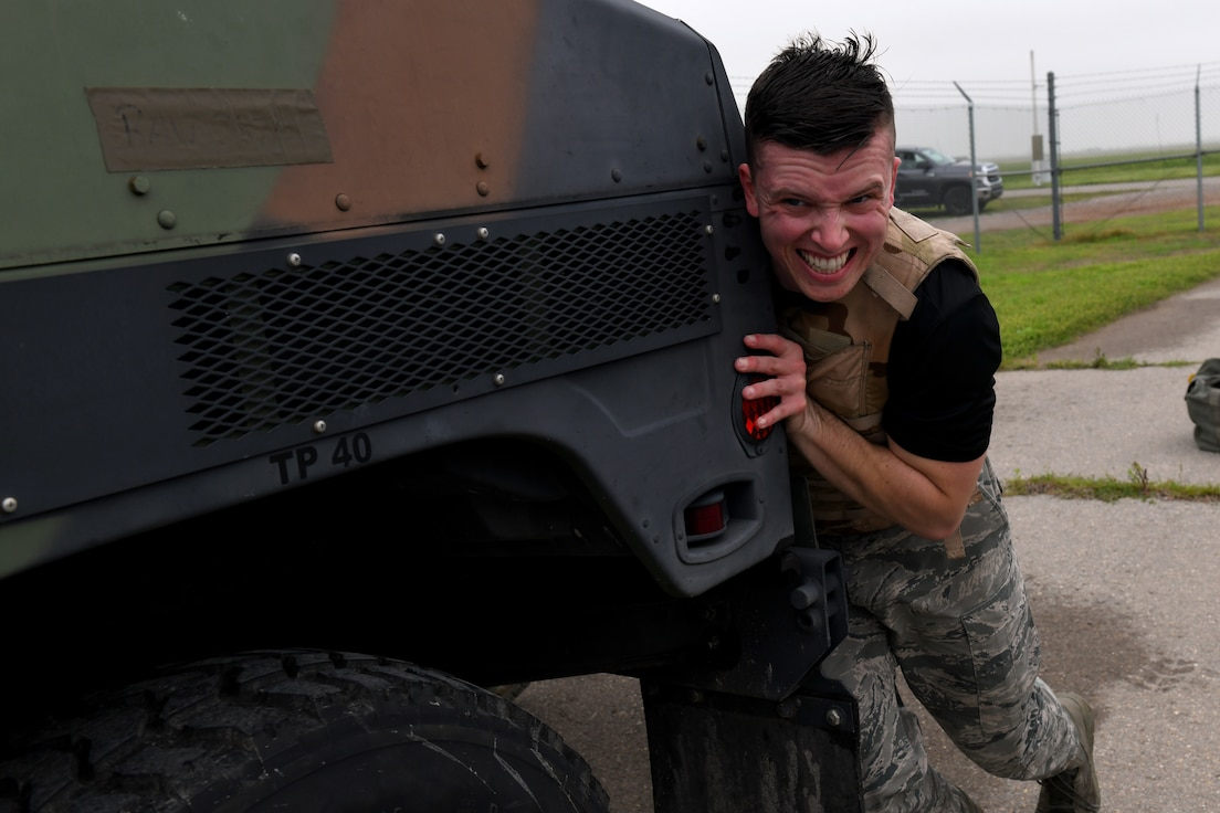 U.S. Air Force Senior Airman Jonathan Yerger, 97th Communication Squadron Radio Frequency Transmission Technician, pushes a High Mobility Multipurpose Wheeled Vehicle during the Logistics Readiness Squadron Warrior Challenge May 6, 2019, at Altus Air Force Base, Okla. While participating in the event, competitors completed challenges measuring both their physical strength and military knowledge. (U.S. Air Force photo by Technical Sergeant Robert Sizelove)