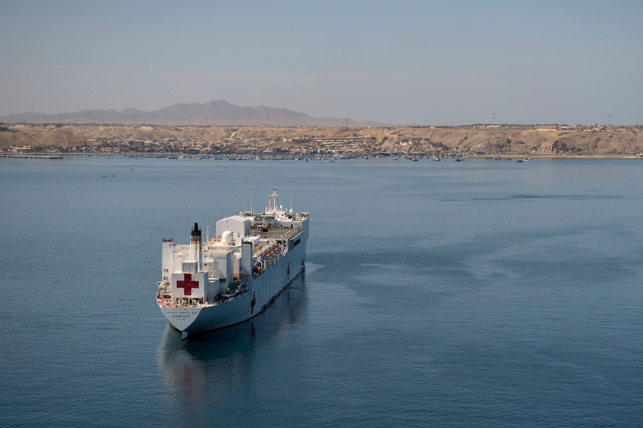 A hospital ship is anchored in the water.