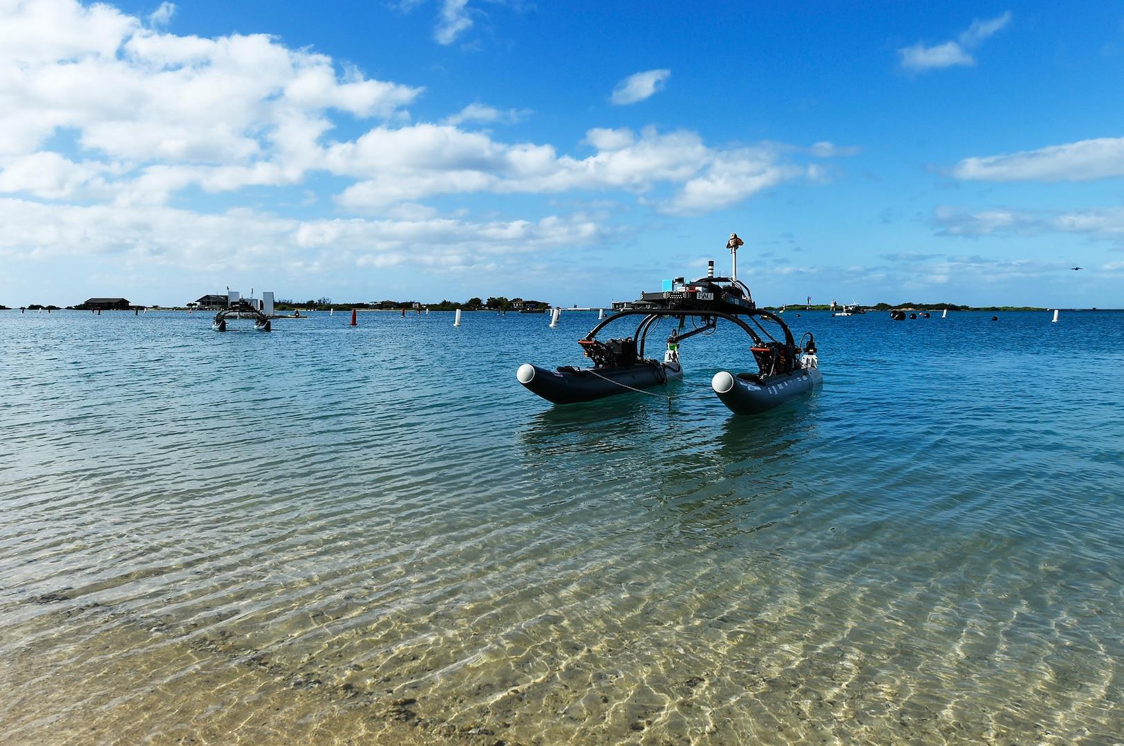 Owltonomous, autonomous surface vehicle from Florida Atlantic University, competes during Office of Naval Research–sponsored Maritime RobotX Challenge, Honolulu, Hawaii, December 14, 2018 (U.S. Navy/John F. Williams)