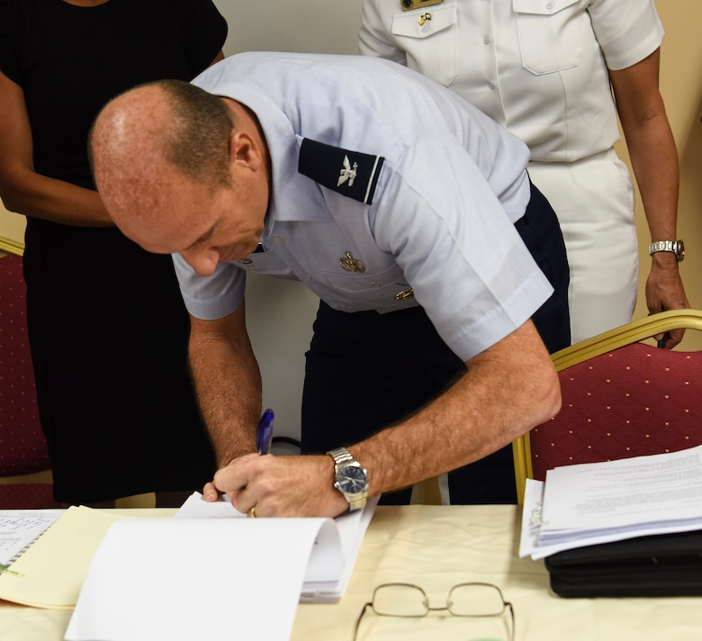 Col. Michael Gimbrone, respresenting U.S. Air Force Pacific Air Forces, signs the Tinian Airfield divert lease May 3, 2019, at Tinian Airport, Commonwealth of the Northern Mariana Islands. The lease is a 40-year agreement intended to benefit both the USAF and Tinian by providing the Air Force a divert runway and stimulating economic growth on Tinian. (U.S. Air Force photo by Tech. Sgt. Jake Barreiro)