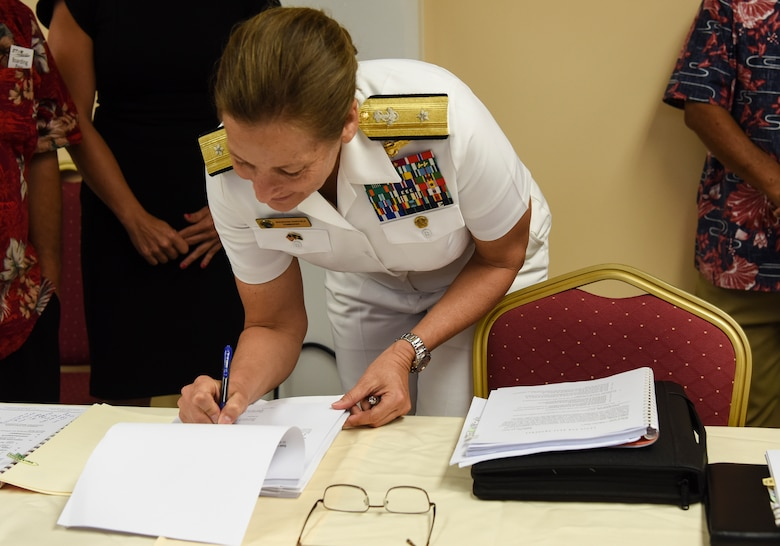 Rear. Adm. Shoshana Chatfield, Joint Region Marianas commander, signs the Tinian Divert airfield lease May 3, 2019, at Tinian Airport, Commonwealth of the Northern Mariana Islands. The $21.9 million lease signing was the culmination of nearly five years of negotiations between the Department of Defense, CNMI government, and Commonwealth Port Authority. (U.S. Air Force photo by Tech. Sgt. Jake Barreiro)
