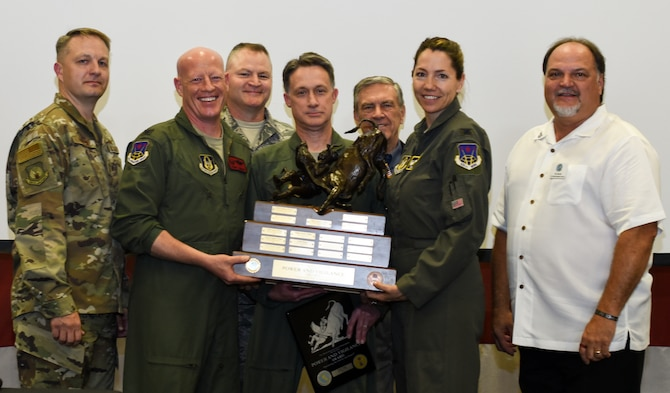926th Wing leadership celebrate alongside Tenth Air Force senior leaders and representatives from the Air Power Council as they receive the Power and Vigilance Award on May 7, 2019, at Naval Air Station Fort Worth Joint Reserve Base, Texas. The award is presented to the 10 AF unit that best exhibits the Numbered Air Force's vision, which is to be the premier provider of affordable, integrated, flexible and mission-ready Reserve Citizen Airmen to execute power and vigilance in support of U.S. National Security. (U.S. Air Force photo by Ms. Melissa Harvey)